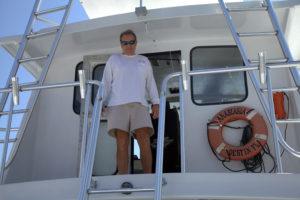 Captain Tony Davis aboard The Anastasia