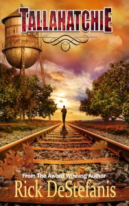 Tallahatchie Book cover man walking near railroad tracks southern town